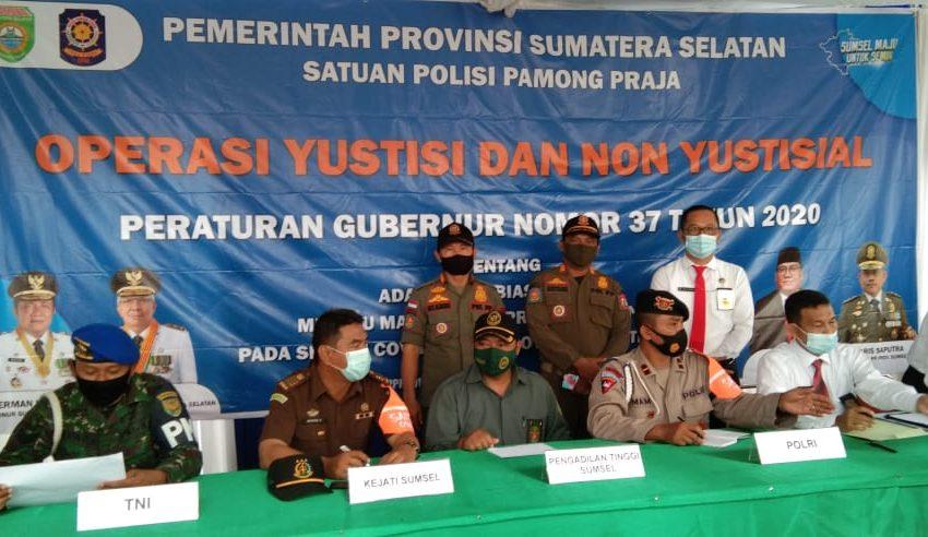 Sinergitas Satpol PP Provinsi Sumsel dan Banyuasin Upaya Putus Mata Rantai Penyebaran Covid-19